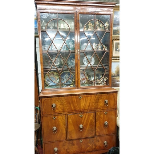 61 - A superb Regency Mahogany Inlaid Bookcase with astragal glazed doors and lions head handles and with...