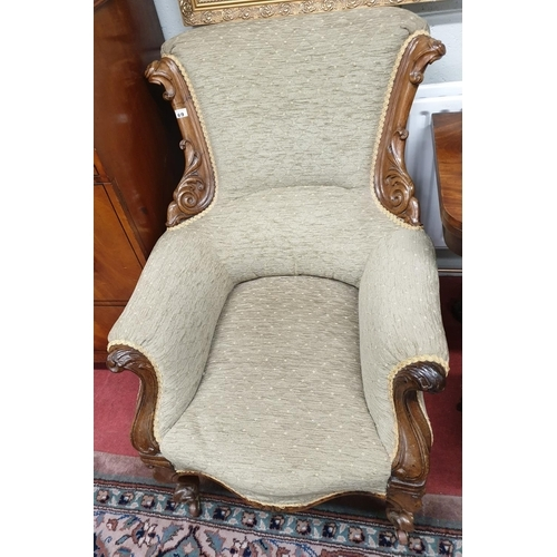 69 - A lovely 19th Century Rosewood Showframe Armchair with a highly carved back and front....