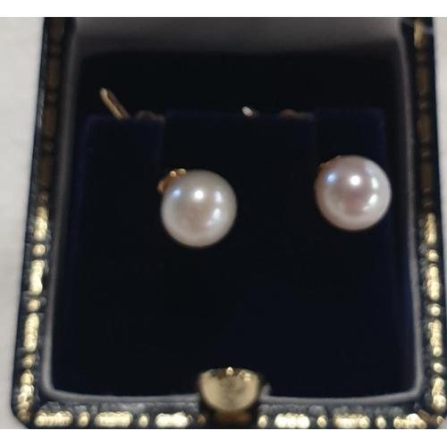 153j - A pair of cultured pearl Earrings....