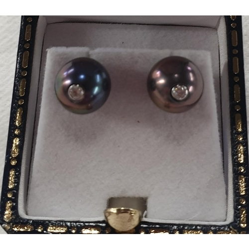 153l - A pair of 18ct gold diamond and pearl Earrings....
