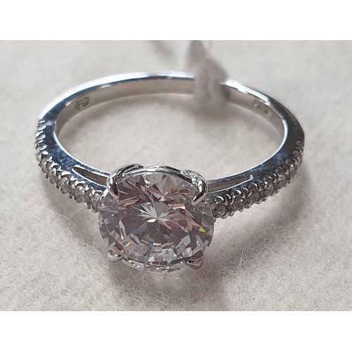 153s - A 9ct gold Cz solitaire Ring....