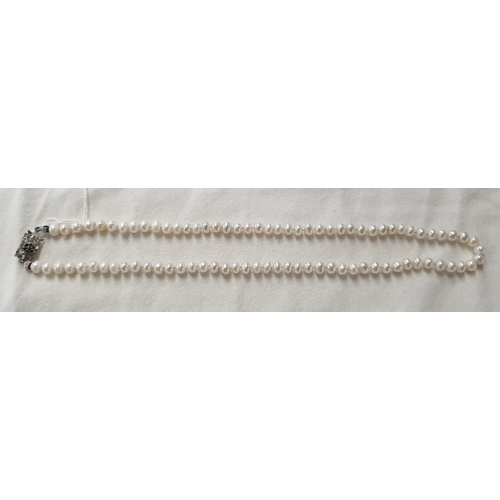 153v - A good cultured pearl Necklet with a white gold and diamond clasp....