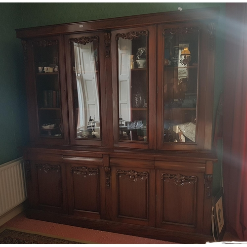 10 - A very large Mahogany four door Bookcase with a glazed top and panelled door base. 212 L x 216 H x 5...