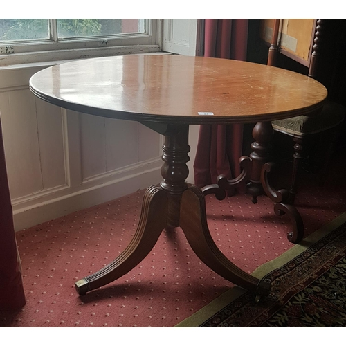 21 - A good Mahogany Circular Supper Table with reeded base and brass toe casters. 90cm diameter....