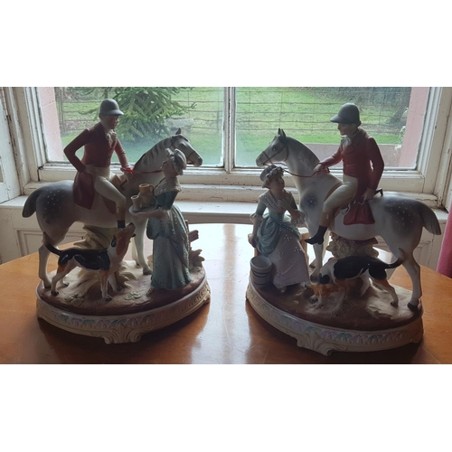 22 - A pair of Porcelain Hunting Figures....