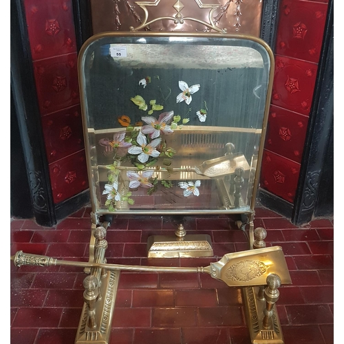 55 - An Art Nouveau Brass Screen along with a quantity of fireside items....