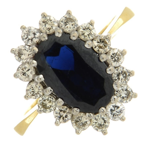 4 - A sapphire and diamond cluster ring. Sapphire calculated weight 2.80cts, based on estimated dimensio...