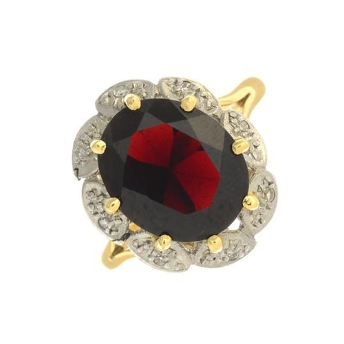 8 - A garnet and diamond cluster ring. Garnet calculated weight 4.61cts, based on estimated dimensions o...