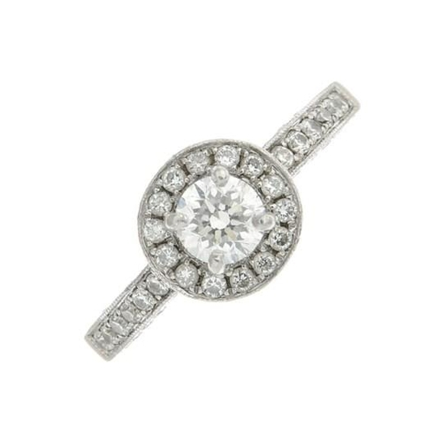 9 - A platinum diamond cluster ring. Estimated total diamond weight 1ct, principal diamond estimated 0.5...