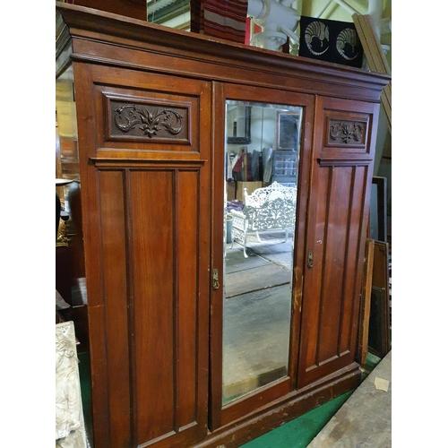 6420 - A late Victorian mahogany three door Wardrobe with mirrored centre. (1) (19/1)....