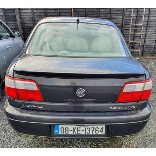 2 - A 2000 Vauxhall Omega 3.1 V6. Automatic with cream leather seats. No paperwork....