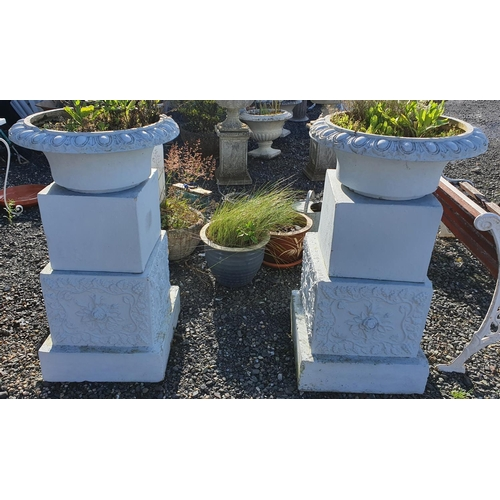 28 - A large pair of reconstituted Stone Urns of unusual feature....
