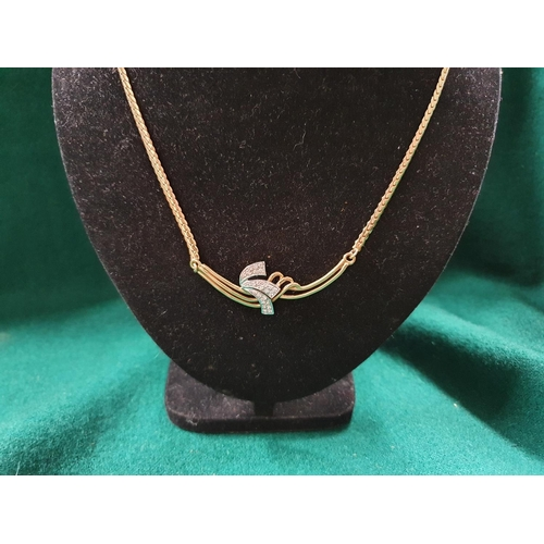 19 - An 18ct Gold and Diamond Necklace with rope chain. Total weight 13 grms....