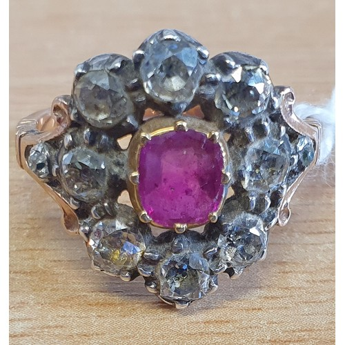 13 - An early Victorian Ruby and Diamond cluster Ring set in rose gold. Approx diamond weight 1.5 - 2cts....
