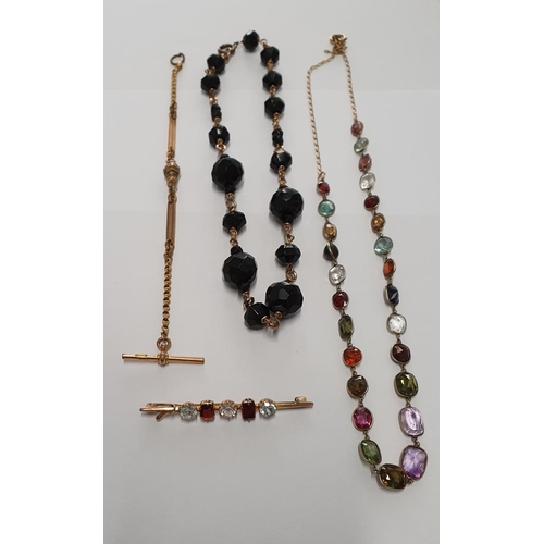11 - A 9ct Gold Necklace with semi precious stones,a Brooch,Necklace and T-bar....