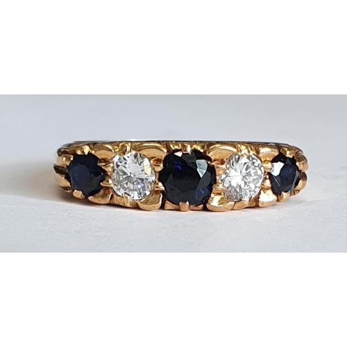1005 - An 18ct. Gold, Sapphire and Diamond Ring. Colour H-I. Clarity SI. Size N½.