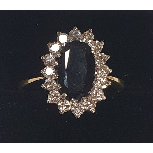 1004a - A fantastic 18ct gold, Sapphire and Diamond Ring. The center Sapphire being 2.8ct. Size R