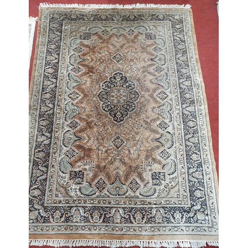 12 - A good brown ground Rug with multi borders and all over design.223 X 156 cms....