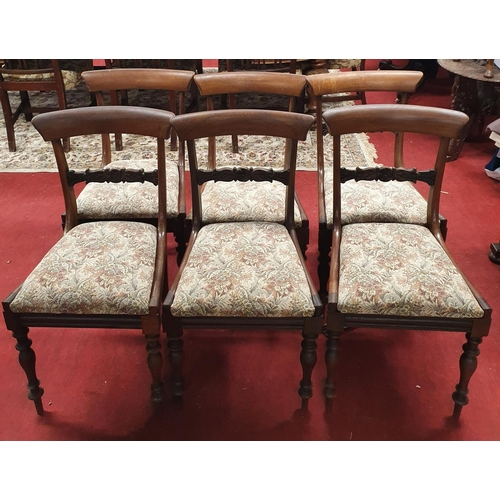 16 - A good set of six Early Victorian Mahogany Dining Chairs with slip in seats on turned supports....