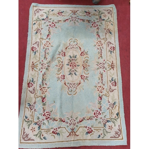 26 - An Aubusson design Rug.120 X 180 cms....