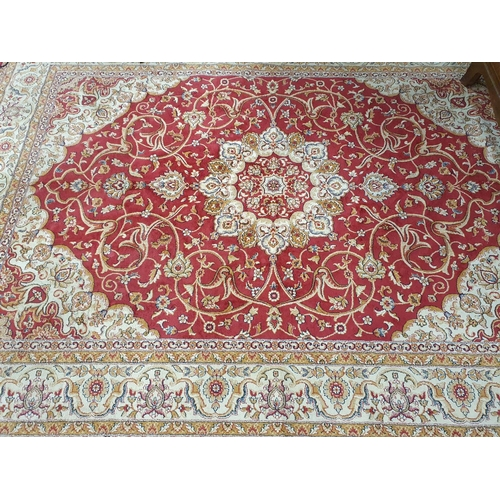 25 - A cream ground Carpet with red outline and multi borders.280 X 200 cms....