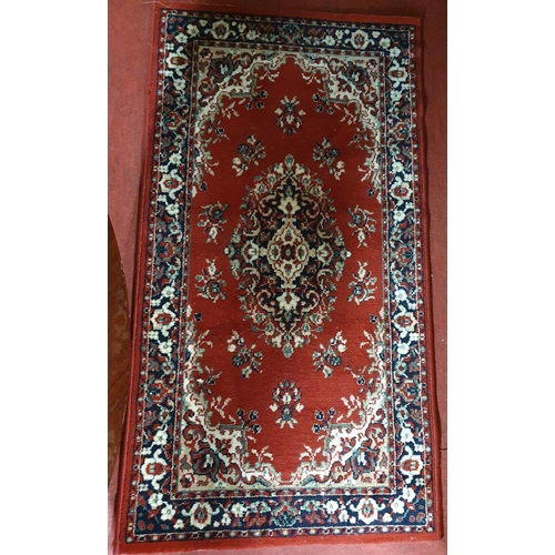 27 - A small red ground Rug.150 X 80 cms....