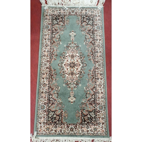 4 - A nice pair of green ground Keshan Rugs with hand knitted fringes.152 X 69 each....