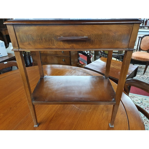 9 - An Early 20th Century neat Mahogany Side Table with drop front and square tapered supports.53 X 30 X...