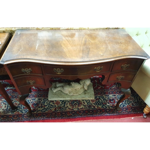 9 - A late 19th early 20th Century Serpentine fronted Mahogany Desk with cabriole supports. 106 x 50 x 7...