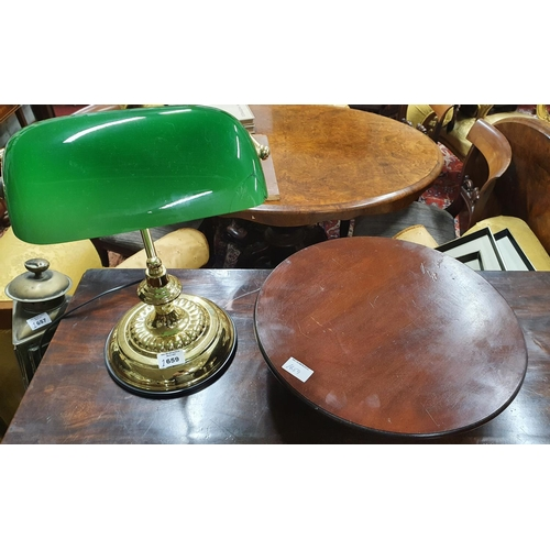 10 - A Mahogany Lazy Suzie,diameter 36 cms along with a Desk Lamp (glass broken) along with some silver p...