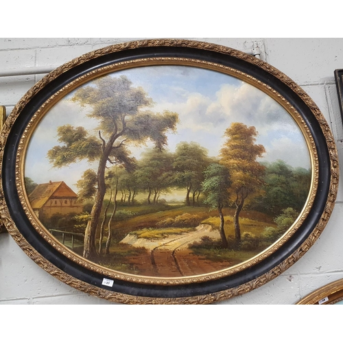 31 - A large Oval Oil on Canvas of a country scene in a gilt and ebonised frame. No signature.100 x 76 cm...