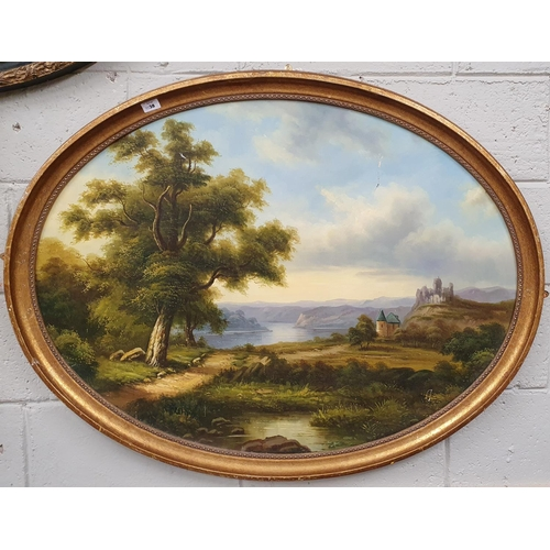 32 - A large Oval Oil on Canvas of a country scene in a gilt and ebonised frame. No signature.100 x 65 cm...