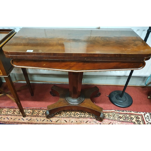 558 - Of Superb quality. An early 19th Century Mahogany Foldover Card Table with pedestal base. In very go...