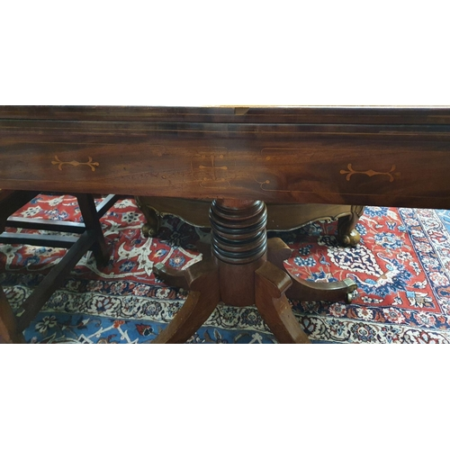 560 - Of superb quality a Regency Mahogany and inlaid fold over Card Table on turned quatrefoil base and r...