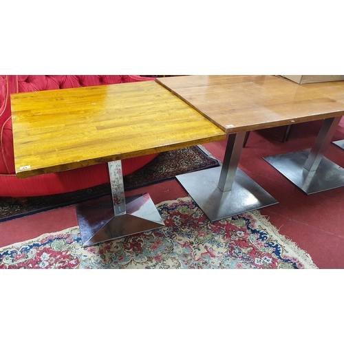 55 - A Chrome based Dining Table with solid Walnut tops. 89 x 89 x H 76cm approx. NB. This is a generic p...