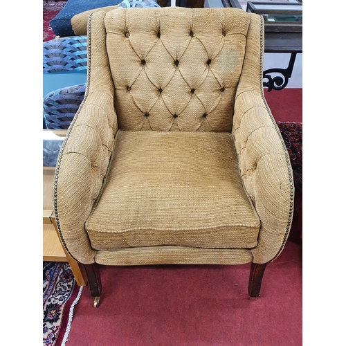 57 - A well upholstered deep buttoned back Armchair.