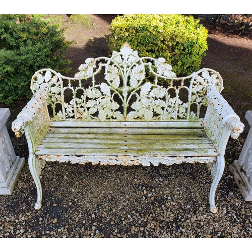A really good heavy cast Iron Garden Bench with oak leaf scroll design and dogs head arms.