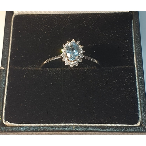 12 - 18ct gold topaz and diamond cluster ring, hallmarks for Sheffield, ring size L1/2, 2.5gms.