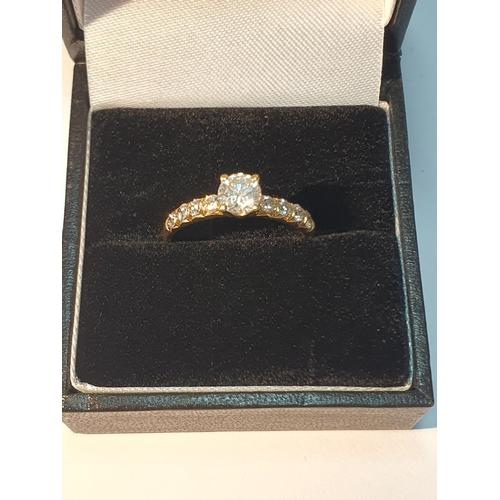 15 - An 18ct gold brilliant-cut diamond single-stone ring. Principal diamond estimated weight 0.50ct, H-I...