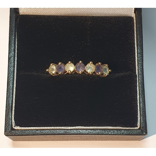 4 - 9ct gold amethyst and paste seven-stone ring, hallmarks for Birmingham, ring size N, 1.6gms.