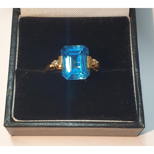 6 - A blue topaz and brilliant-cut diamond dress ring. Topaz weight 5cts, stamped to band. Stamped K18. ...