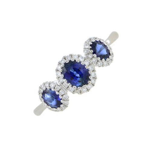 1 - A sapphire and diamond dress ring. Total sapphire weight 0.84ct, stamped to mount. Total diamond wei...