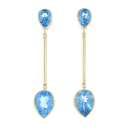 7 - A pair of 9ct gold blue topaz earrings. Hallmarks for Birmingham, 2006.Length 6cms. 10.6gms.