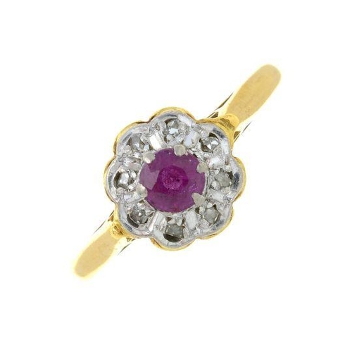 9 - A ruby and vari-cut diamond cluster ring. Stamped 18ct.Ring size P. 3.2gms.