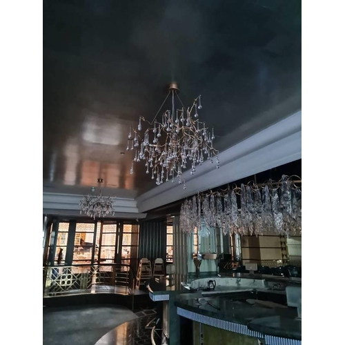 53 - A Fabulous Gilt Chandelier with Crystal droplets.  Property of the most iconic and historic 5 star h...