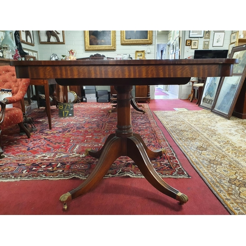 46 - A really good Regency style three pillar Boardroom Table on tripod supports with two leaves. Fully e...