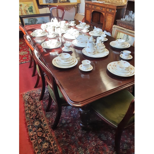 59 - A good mid Victorian Mahogany two leaf Dining Table with turned and fluted supports. W 122 x 230 x H...