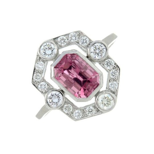 A pink tourmaline and brilliant-cut diamond cluster ring. Tourmaline calculated weight 1.10cts, based on estimated dimensions of 7 by 5 by 4mms.Estimated total diamond weight 0.30ct.Stamped Plat. Ring size N. 3.6gms.