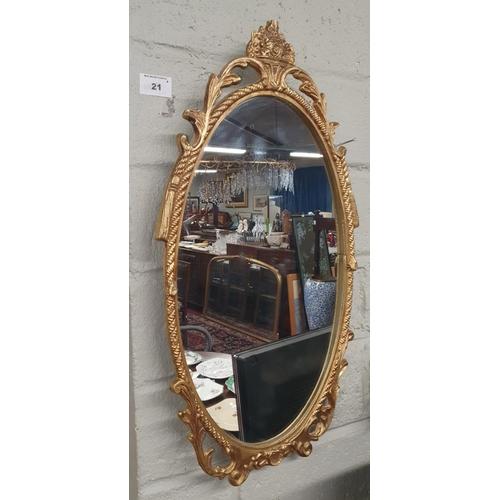 21 - A Metal framed Mirror. 26 x 50 cm approx.