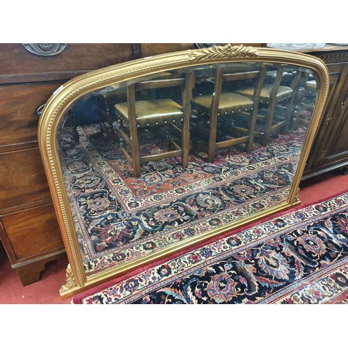 34 - A good Gilt arched Overmantel with bevelled glass. W 128 x H 92 cm approx.